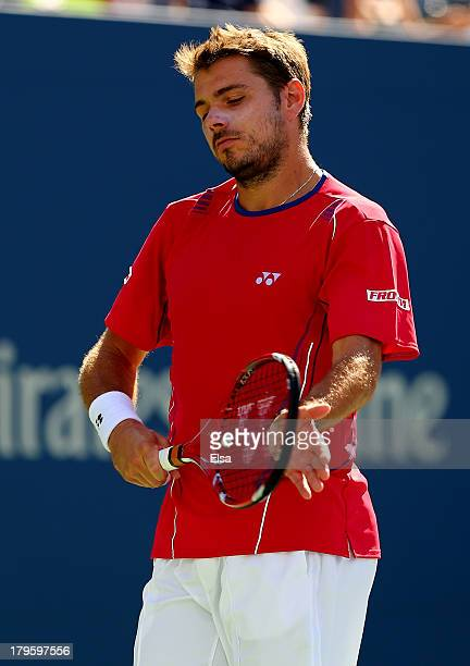Stanislas Wawrinka of Switzerland looks on during his men's singles quarterfinal match against Andy Murray of Great Britain on Day Eleven of the 2013...