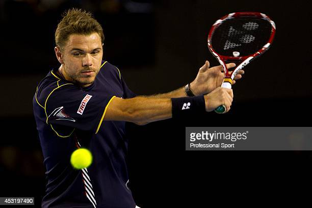 Stanislas Wawrinka of Switzerland plays a backhand in his fourth round match against Novak Djokovic of Serbia during day seven of the 2013 Australian...