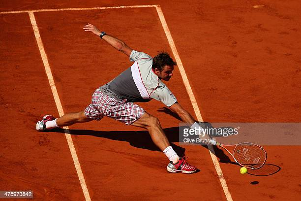 Stanislas Wawrinka of Switzerland plays a backhand in his Men's Semi Final against JoWilfried Tsonga of France on day thirteen of the 2015 French...