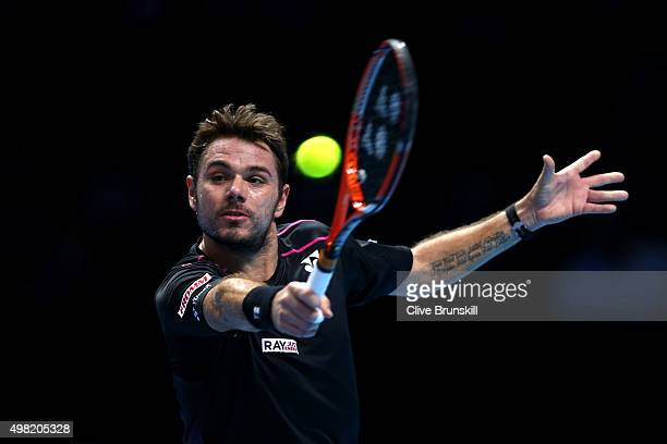 Stanislas Wawrinka of Switzerland plays a backhand in his men's semi final against Roger Federer of Switzerland on day seven of the Barclays ATP...