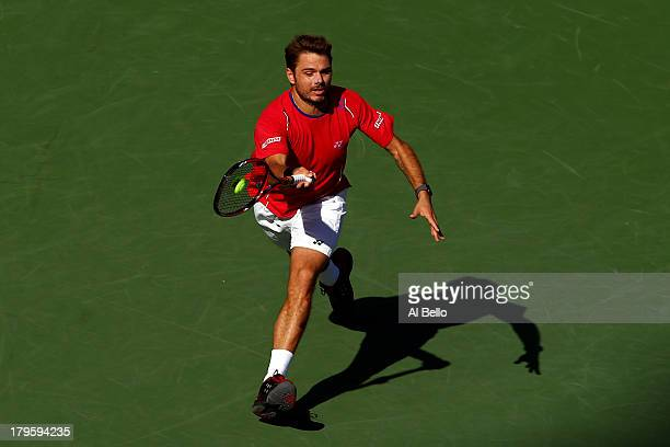 Stanislas Wawrinka of Switzerland plays a forehand during his men's singles quarterfinal match against Andy Murray of Great Britain on Day Eleven of...