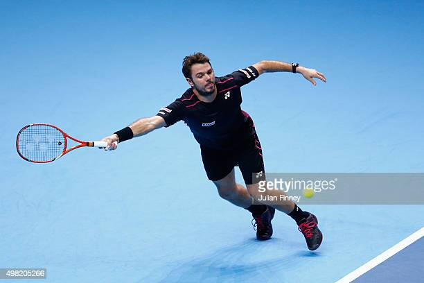 Stanislas Wawrinka of Switzerland plays a forehand in his men's semi final against Roger Federer of Switzerland on day seven of the Barclays ATP...