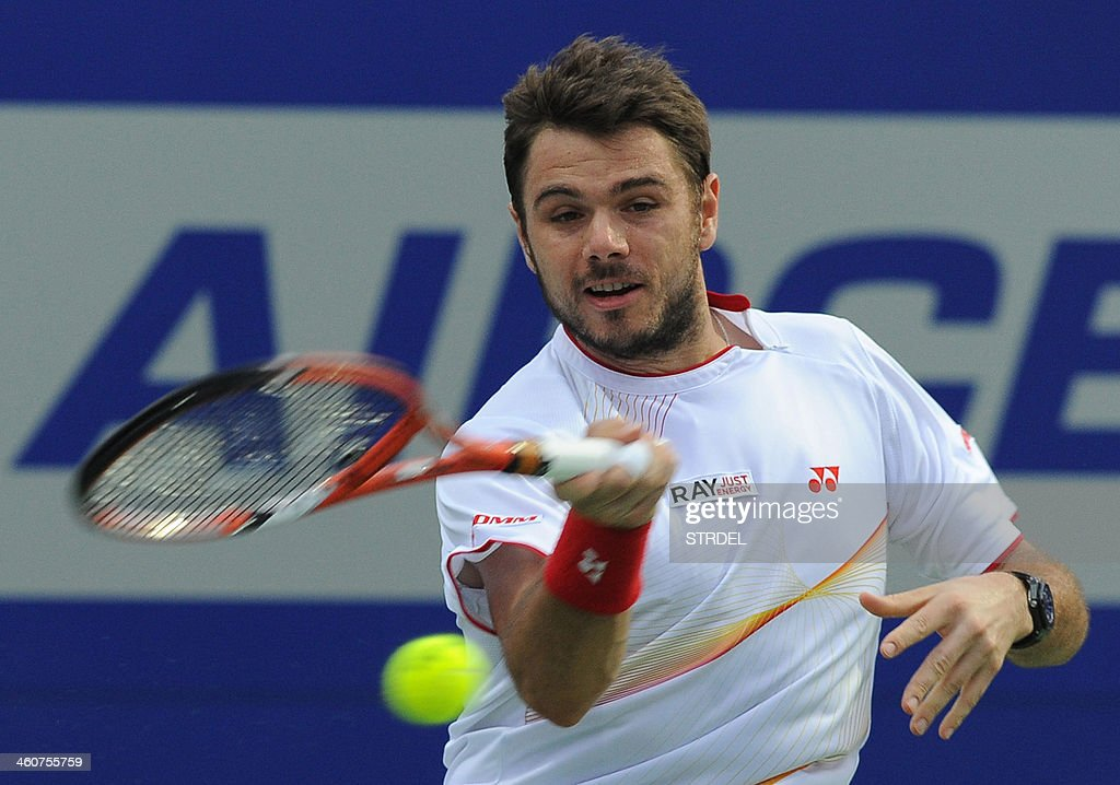 Stanislas Wawrinka of Switzerland plays a shot aganist Edouard Roger-Vasselin of France during their tennis final match at the Chennai Open in Chennai on January 5, 2014.