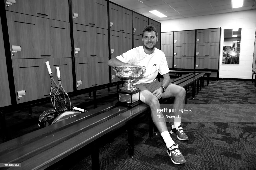 Stanislas Wawrinka of Switzerland poses with the Norman Brookes Challenge Cup in the players dressing room after winning his men's final match against Rafael Nadal of Spain during day 14 of the 2014 Australian Open at Melbourne Park on January 26, 2014 in Melbourne, Australia.