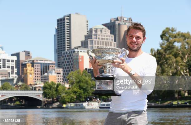 Stanislas Wawrinka of Switzerland poses with the Norman Brookes Challenge Cup at Melbourne University Boat Club, after winning the 2014 Australian...