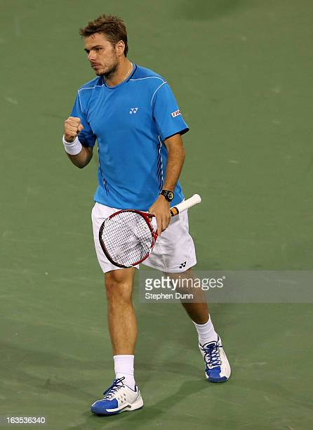 Stanislas Wawrinka of Switzerland pumps his fist after winning the first set of his match with Lleyton Hewitt of Australia during day 6 of the BNP...