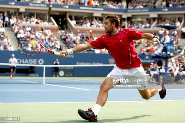 Stanislas Wawrinka of Switzerland returns a backhand during his men's singles semifinal match against Novak Djokovic of Serbia on Day Thirteen of the...