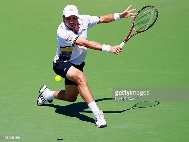 Stanislas Wawrinka of Switzerland returns a backhand to Nicolas Almagro of Spain during Day 1 of the Western & Southern Financial Group Masters at...