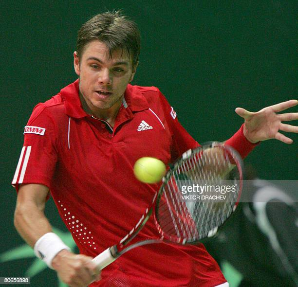 Stanislas Wawrinka of Switzerland returns a service to Vladimir Voltchkov of Belarus during the second round of the Davis Cup Europe/Africa Zone...