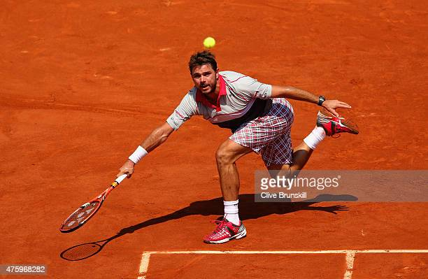 Stanislas Wawrinka of Switzerland returns a shot in his Men's Semi Final against JoWilfried Tsonga of France on day thirteen of the 2015 French Open...