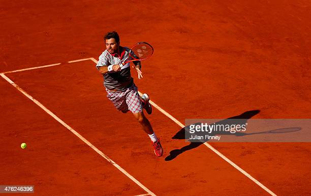 Stanislas Wawrinka of Switzerland returns a shot in the Men's Singles Final against Novak Djokovic of Serbia on day fifteen of the 2015 French Open...