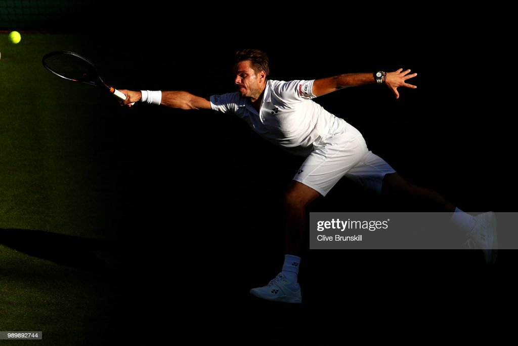 Stanislas Wawrinka of Switzerland returns against Grigor Dimitrov of Bulgaria during their Men's Singles first round match on day one of the Wimbledon Lawn Tennis Championships at All England Lawn Tennis and Croquet Club on July 2, 2018 in London, England.