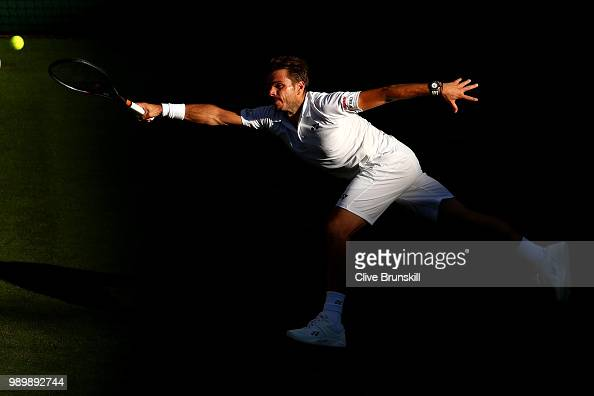 Stanislas Wawrinka of Switzerland returns against Grigor Dimitrov of Bulgaria during their Men's Singles first round match on day one of the...