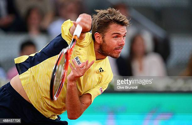 Stanislas Wawrinka of Switzerland serves against Dominic Thiem of Austria in their second round match during day four of the Mutua Madrid Open tennis...