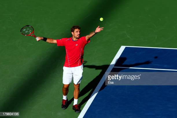 Stanislas Wawrinka of Switzerland serves during his men's singles quarterfinal match against Andy Murray of Great Britain on Day Eleven of the 2013...