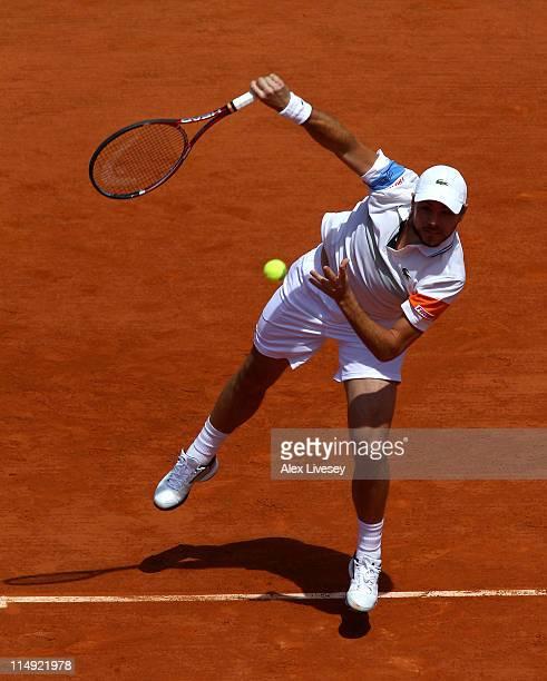 Stanislas Wawrinka of Switzerland serves during the men's singles round four match between Stanislas Wawrinka of Switzerland and Roger Federer of...