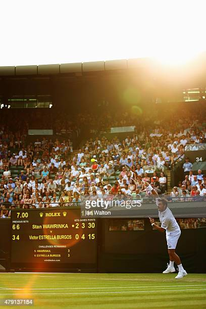 Stanislas Wawrinka of Switzerland serves in his Gentlemens Singles Second Round match against Victor Estrella Burgos of Dominican Republic during day...