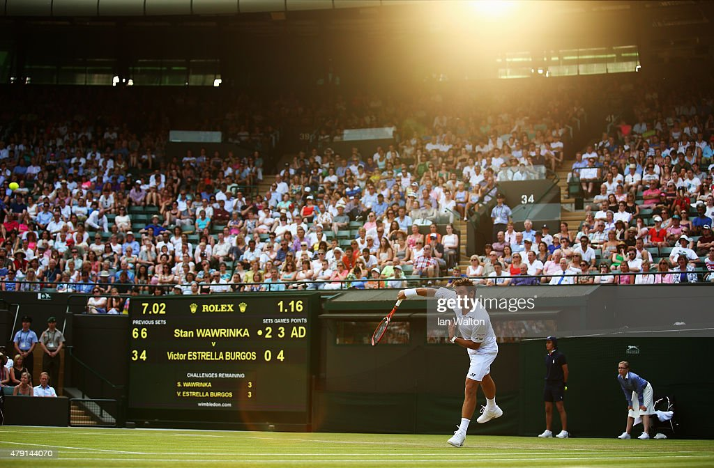 Stanislas Wawrinka of Switzerland serves in his Gentlemens Singles Second Round match against Victor Estrella Burgos of Dominican Republic during day three of the Wimbledon Lawn Tennis Championships at the All England Lawn Tennis and Croquet Club on July 1, 2015 in London, England.