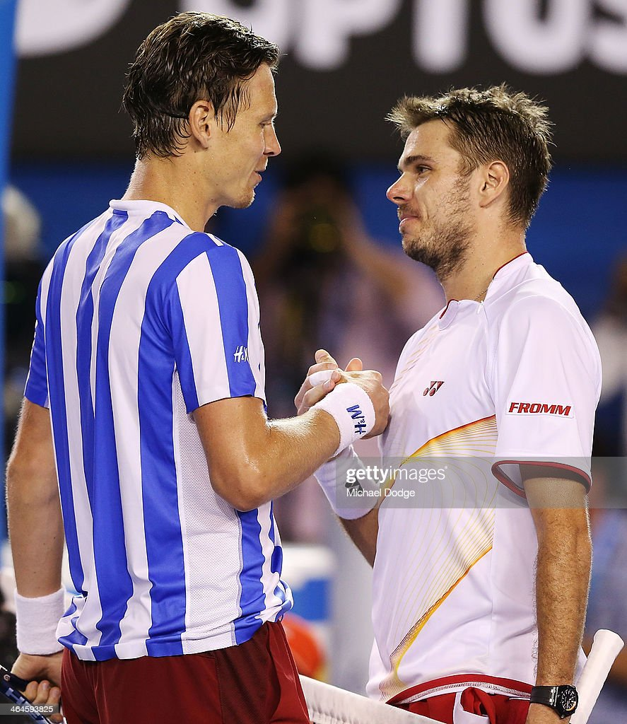 Stanislas Wawrinka (R) of Switzerland shakes hands after winning his semifinal match against Tomas Berdych of the Czech Republic during day 11 of the 2014 Australian Open at Melbourne Park on January 23, 2014 in Melbourne, Australia.