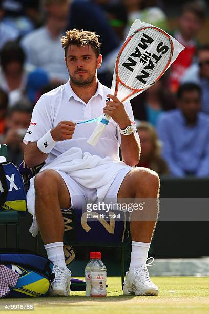 Stanislas Wawrinka of Switzerland sits in his chair between games in his Gentlemens Singles Quarter Final match against Richard Gasquet of France...
