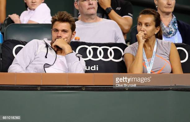 Stanislas Wawrinka of Switzerland sits with Iva Majoli coach of Donna Vekic of Croatia to watch her straight sets victory against Alison Riske of the...