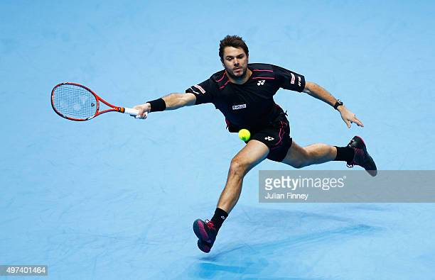 Stanislas Wawrinka of Switzerland stretches for a forehand in his men's singles match against Rafael Nadal of Spain during day two of the Barclays...