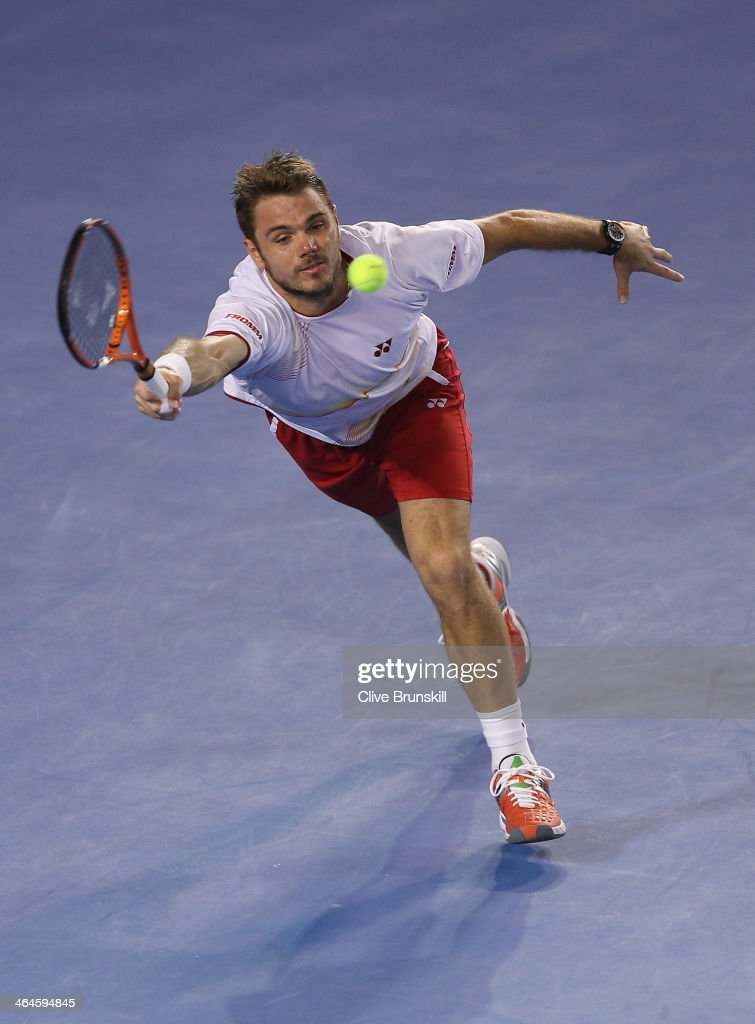 Stanislas Wawrinka of Switzerland stretches to play a forehand in his semifinal match against Tomas Berdych of the Czech Republic during day 11 of the 2014 Australian Open at Melbourne Park on January 23, 2014 in Melbourne, Australia.