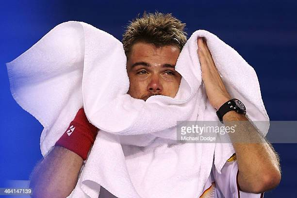 Stanislas Wawrinka of Switzerland wipes his face in his quarterfinal match against Novak Djokovic of Serbia during the 2014 Australian Open at...