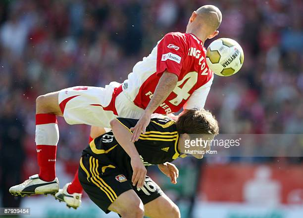Stanislav Angelov of Cottbus battles for the ball with Pirmin Schwegler of Leverkusen during the Bundesliga match between FC Energie Cottbus and...