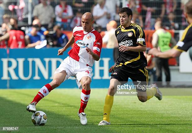 Stanislav Angelov of Cottbus battles for the ball with Tranquillo Barnetta of Leverkusen during the Bundesliga match between FC Energie Cottbus and...