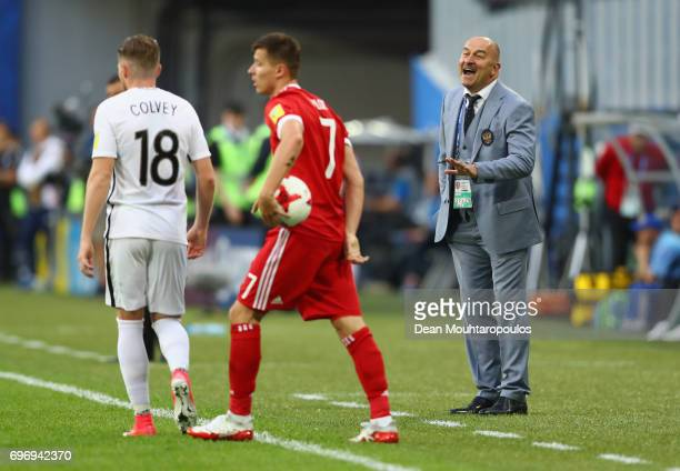 Stanislav Cherchesov head coach of Russia gives his team instructions during the FIFA Confederations Cup Russia 2017 Group A match between Russia and...