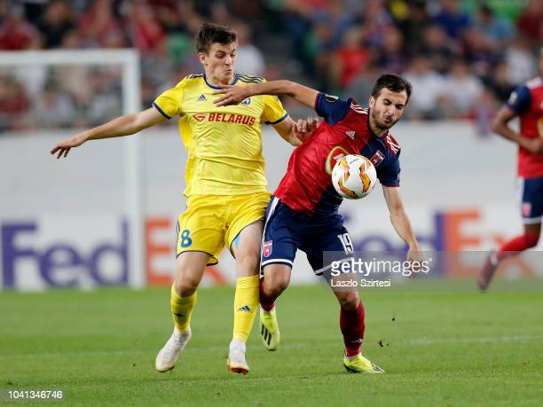 Stanislav Dragun of FC BATE Borsiov fights for the ball with Boban Nikolov of Vidi FC during the UEFA Europa League Group Stage match between Vidi FC...
