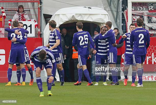 Stanislav IIjutcenko of Osnabrueck jubilates with team mates after scoring the first goal during the third league match between FC Energie Cottbus...