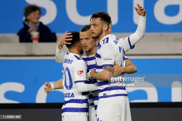 Stanislav Iljutcenko of Duisburg celebrates the first goal with Cauly Oliveira Souza and Borys Tashchy of Duisburg during the Second Bundesliga match...