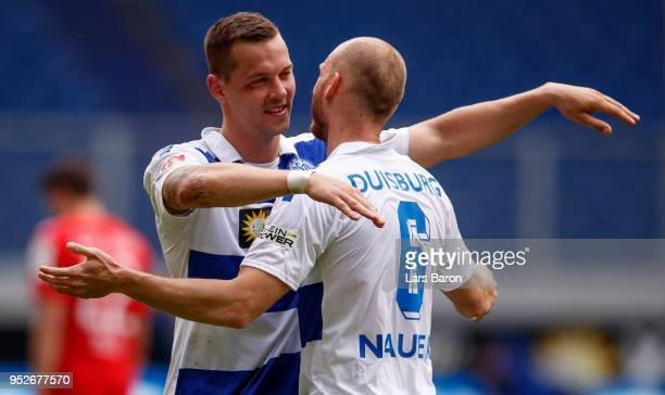 Stanislav Iljutcenko of Duisburg celebrates with Gerrit Nauber of Duisburg after winning the Second Bundesliga match between MSV Duisburg and SSV...