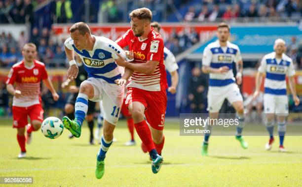 Stanislav Iljutcenko of Duisburg is challenged by Benedikt Gimber of Regensburg during the Second Bundesliga match between MSV Duisburg and SSV Jahn...