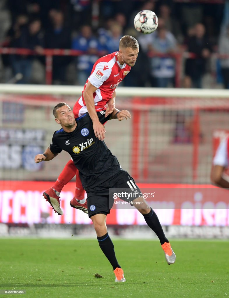 Stanislav Iljutcenko of MSV Duisburg and Marvin Friedrich of 1 FC Union Berlin during the game between Union Berlin and the MSV Duisburg at the Stadion an der Alten Foersterei on september 14, 2018 in Berlin, Germany.