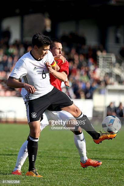Stanislav Ivanov of Bulgaria challenges Atakan Akkaynak of Germany during the U17 Euro Qualification match between Germany and Bulgaria at Stadium...