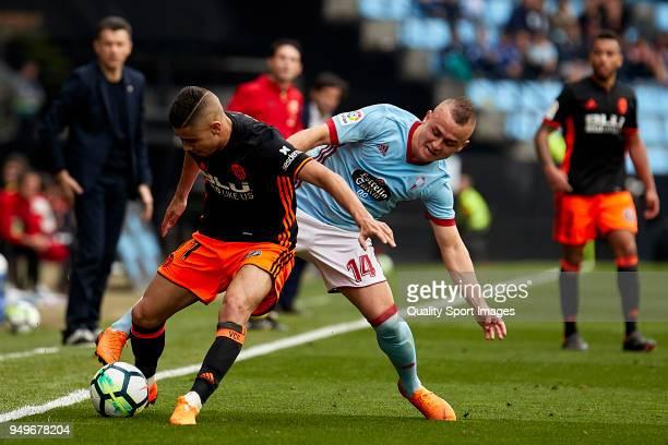 Stanislav Lobotka of Celta de Vigo competes for the ball with Andreas Pereira of Valencia CF during the La Liga match between Celta de Vigo and...