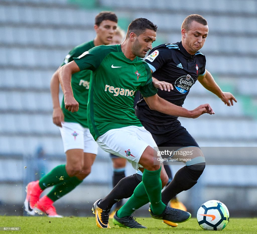 Stanislav Lobotka (R) of Celta de Vigo competes for the ball with Victor Vazquez (L) of Racing de Ferrol during the pre-season friendly match between Celta de Vigo and Racing de Ferrol at A Malata Stadium on July 22, 2017 in Ferrol, Spain.