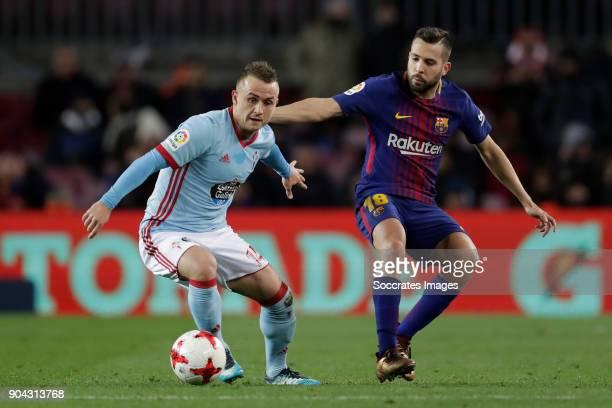 Stanislav Lobotka of Celta de Vigo Jordi Alba of FC Barcelona during the Spanish Copa del Rey match between FC Barcelona v Celta de Vigo at the Camp...