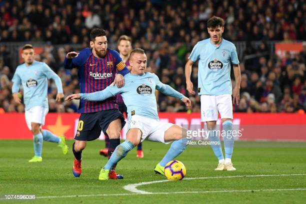 Stanislav Lobotka of Celta Vigo is challenged by Lionel Messi of Barcelona during the La Liga match between FC Barcelona and RC Celta de Vigo at Camp...