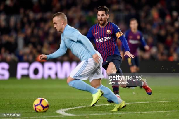 Stanislav Lobotka of Celta Vigo is under pressure by Lionel Messi of Barcelona during the La Liga match between FC Barcelona and RC Celta de Vigo at...