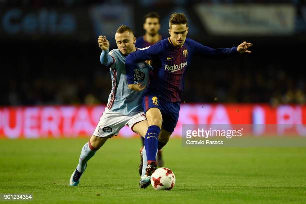 Stanislav Lobotka of RC Celta de Vigo competes for the ball with Denis Suarez of FC Barcelona during the Copa del Rey round of 16 first leg match...
