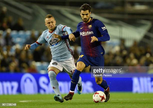 Stanislav Lobotka of RC Celta de Vigo competes for the ball with Andre Gomes of FC Barcelona during the Copa del Rey round of 16 first leg match...