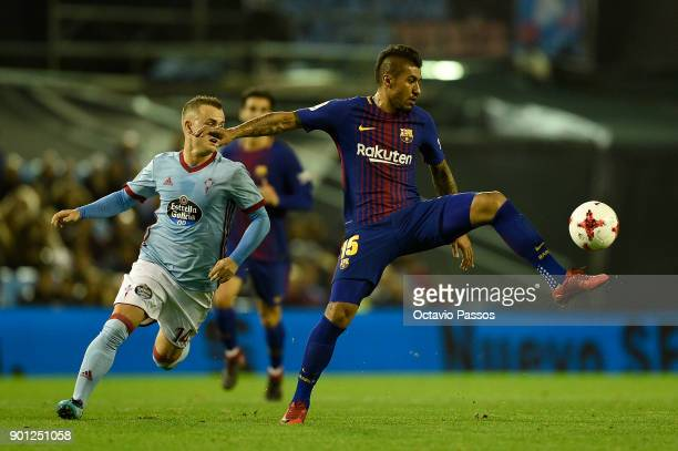 Stanislav Lobotka of RC Celta de Vigo competes for the ball with Paulinho of FC Barcelona during the Copa del Rey round of 16 first leg match between...