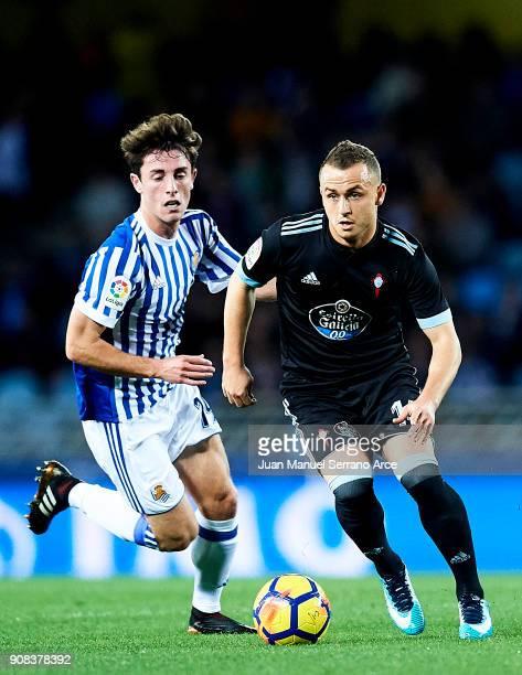 Stanislav Lobotka of RC Celta de Vigo duels for the ball with Alvaro Odriozola of Real Sociedad during the La Liga match between Real Sociedad de...
