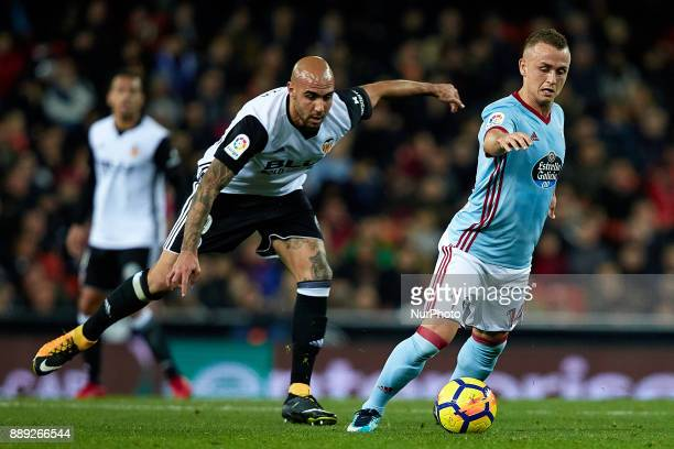 Stanislav Lobotka of Real Club Celta de Vigo competes for the ball with Simone Zaza of Valencia CF during the La Liga game between Valencia CF and...