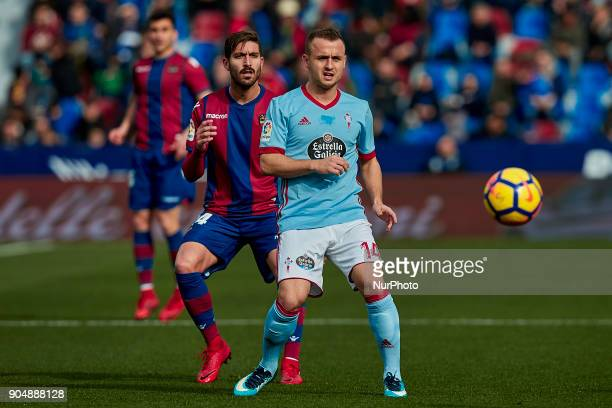 Stanislav Lobotka of Real Club Celta de Vigo looks the ball next to Campana of Levante UD during the La Liga game between Levante UD and Real Club...