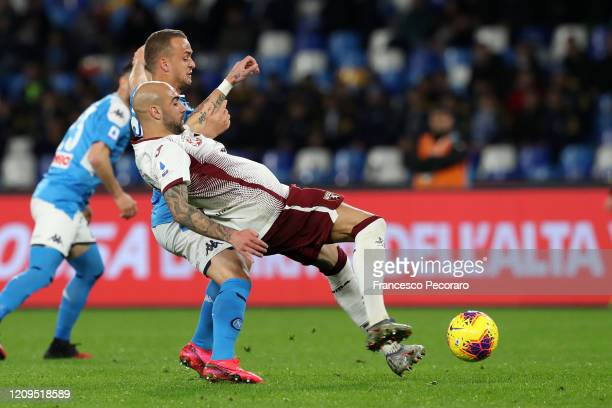 Stanislav Lobotka of SSC Napoli vies with Simone Zaza of Torino FC during the Serie A match between SSC Napoli and Torino FC at Stadio San Paolo on...